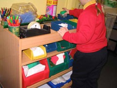 A craft workstation to allow children to choose their own craft materials